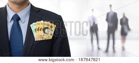 Money South Korean won banknotes in businessman suit pocket - panoramic banner