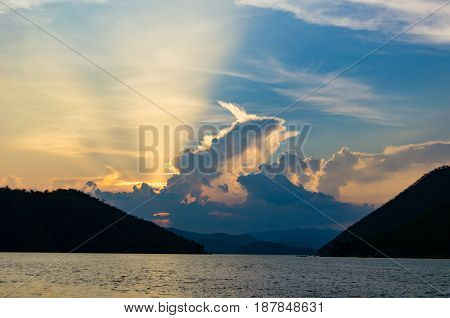 Lake and mountain range with sunset sky background