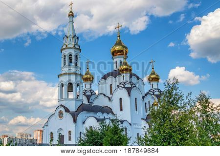 Russian Orthodox church with golden domes on sunny day