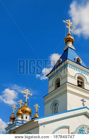 Part of Russian Orthodox church with golden domes on sunny day
