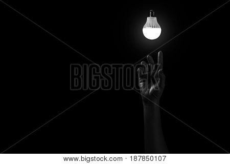 Hand Reaching Out To Light In Black, Hopeful Concept