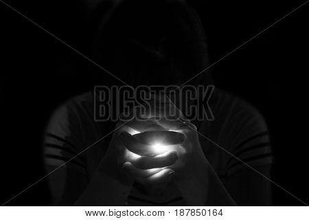 Depress Woman Praying In The Dark, Light Shine In Hand
