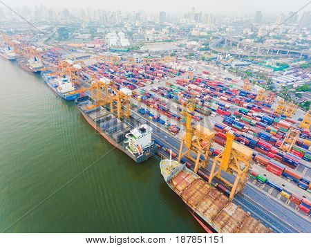 container ship in import export and business logistic.By crane Trade Port Shipping.cargo to harbor.Aerial view.Water transport.International.Shell Marine. container ship concept. container ship aerial view. container ship drone