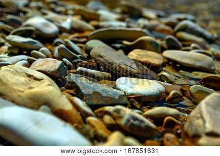 Close up pebbles and stones of mountain river for naturalbackground