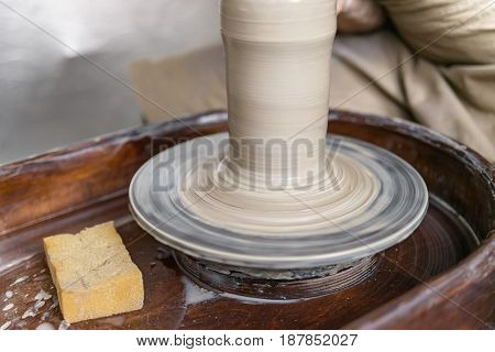 Working on pottery wheel crafting bowl close up