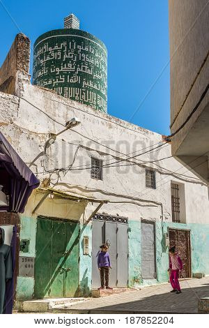 MOULAY IDRISS ZERHOUN, MOROCCO - APRIL 7,2017 - In the streets of Moulay Idriss. Moulay Idriss is a town in northern Morocco is spread over two hills at the base of Mount Zerhoun.