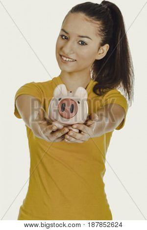 Happy woman holding piggybank.