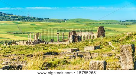 VOLUBILIS ,MOROCCO - APRIL 7,2017 - View at the ruins of Volubulis in Morocco. Volubilis is a partly excavated Berber and Roman city in Morocco situated near the city of Meknes.