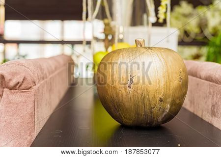 Golden apple on woodent table in restaurant used for interior decoration