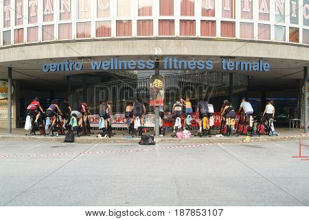 Lugano, Switzerland -17 June 2005: People pedaling during a spinning class