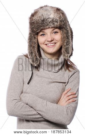Young girl in a winter hat over white background