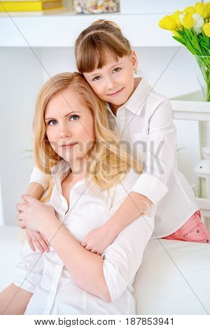 Happy family spending time together. Loving daughter hugs her dear mother.