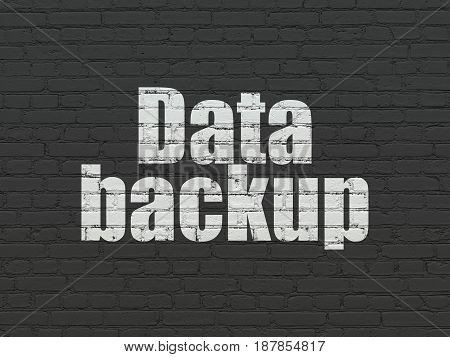 Information concept: Painted white text Data Backup on Black Brick wall background