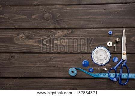 Top View Of Set Of Various Sewing Supplies On Wooden Surface