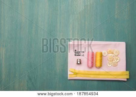 Top View Of Set Of Various Sewing Supplies On Wooden Colorful Surface