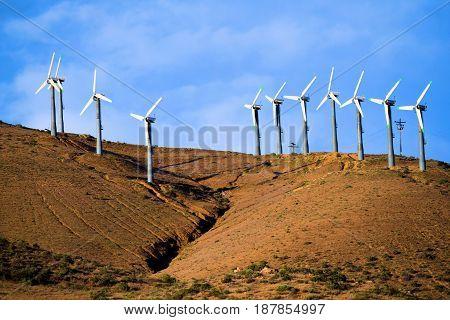 Old technology wind turbines creating alternative green energy taken in Tehachapi Pass, CA