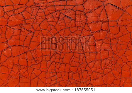 Rusty metal surface with old peeled paint for use as a texture or background.