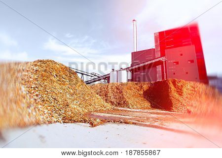 Bio Power Plant With Storage Of Wooden Fuel Against Blue Sky. Toned Image. Motion Blur Effect.