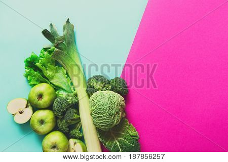 Green vegetables and fruits. Diet, detox and healthy food concept - top view flat lay of vegetarian meals on bright background. Ingredients for salad