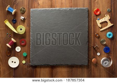 sewing tools and accessories on wooden background