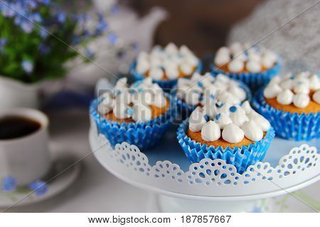 homemade muffins with whipped cream and a flower