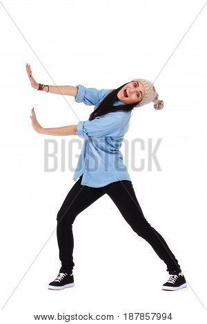 Woman pushing something imaginary isolated over white background