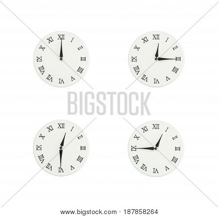 Closeup group of white clock with shadow for decorate show the time in 12 12:15 12:30 12:45 a.m. isolated on white background beautiful 4 wall clock picture in different time