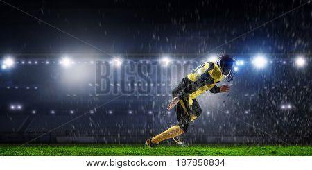 Football player at stadium. Mixed media . Mixed media