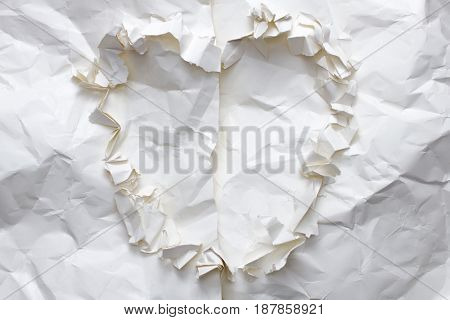 torn crumpled paper material heart shape concept