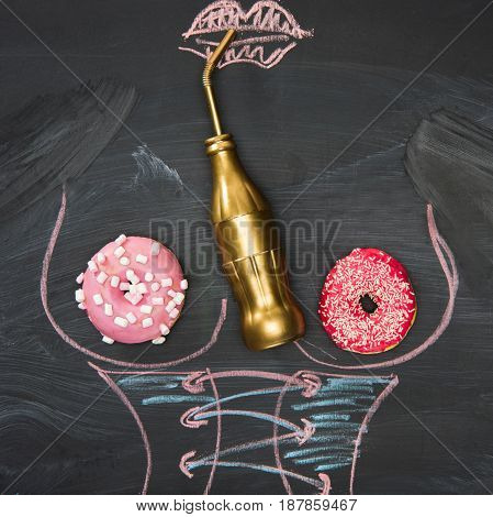Food Still Life With Baked Donuts, Golden Bottle And Picture Of Female Body