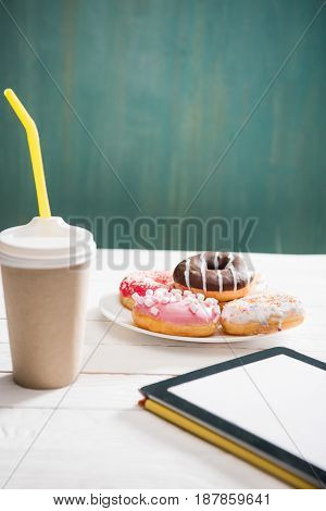 Unhealthy Breakfast With Coffee To Go, Plate Of Frosted Donuts And Digital Tablet With White Screen