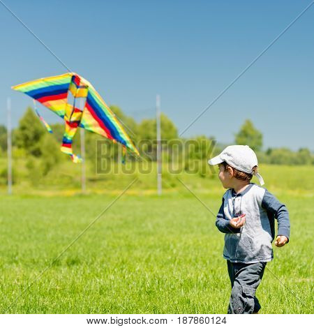 Cute Boy Playing With Kite Outdoors. Color Image, Toned Image
