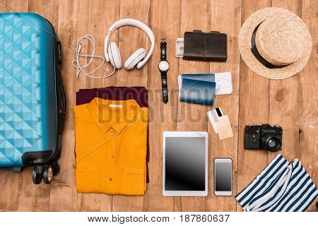 Flat Lay Of Summer Vacation Things Neatly Organized On Wooden Background. Travel Concept.
