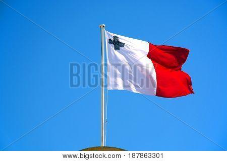 Maltese flag against a blue sky Valletta Malta Europe.