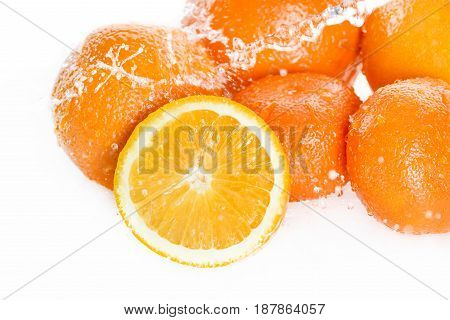 Close-up View Of Fresh Ripe Oranges With Water Drops Isolated On White, Fresh Fruits Falling In Wate