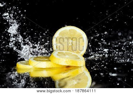Close-up View Of Fresh Sliced Lemon With Water Drops Isolated On Black
