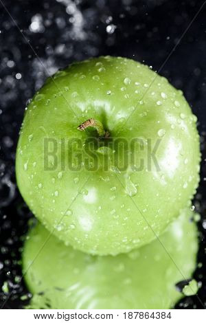 Green Apple In Water With Reflection On Black, Fresh Fruits Concept