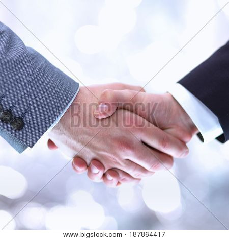 Business people handshake sitting in the office .