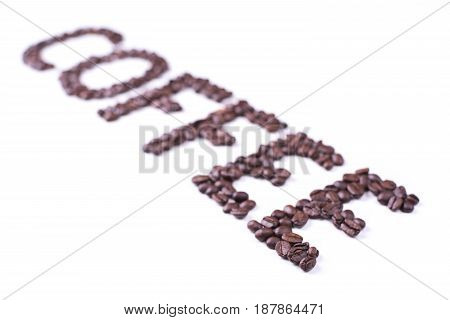 Coffee inscription composed of roasted coffee beans on white background design for your coffee shop