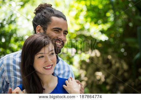 Romantic young couple spending leisure time in park