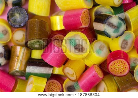 Many sweet colorful fruit candies close up macro