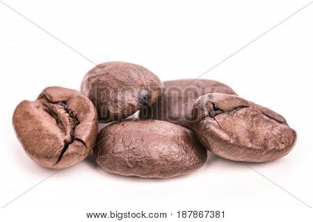 Roasted coffee beans isolated on white background close up