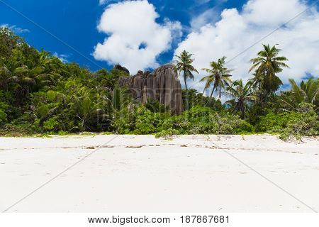 travel, landscape and nature concept - tropical island beach on seychelles