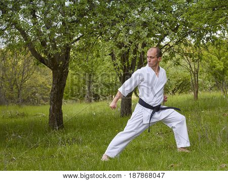 Athlete is training block arm in the park zone