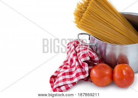 Food in bowl with napkin against white background