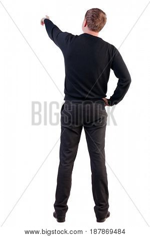 Back view of  pointing young business men in  sweater. blonde businessman  gesture. Rear view people collection.  backside view of person.  Isolated over white background.