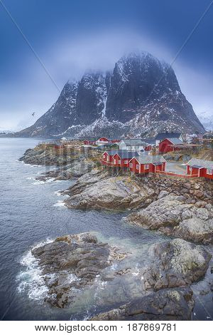 Travel Concepts and Ideas. Traditional Fishing Hut Village in Hamnoy During Early Spring Time in Lofoten Islands Norway. Vertical Image Composition