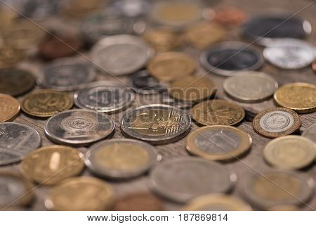 Collection Of Different Coins On Wooden Tabletop, Pile Of Coins Concept