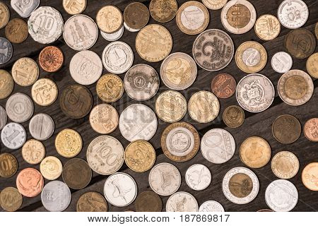 Top View Of Collection Of Different Coins On Wooden Tabletop, Pile Of Coins Concept