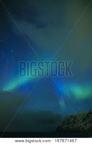 Amazing and Unique Nothern Lights Aurora Borealis Over Lofoten Islands in Norway Over the Polar Circle. Vertical Image Composition